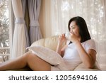 happy asian woman relax with... | Shutterstock . vector #1205694106