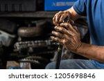 car mechanic or serviceman... | Shutterstock . vector #1205698846