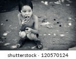 Lone Hungry Boy Eats Sitting O...