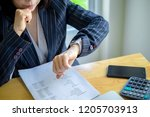 business woman working in... | Shutterstock . vector #1205703913