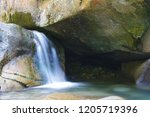 charming refreshing waterfall... | Shutterstock . vector #1205719396