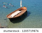 view of the coast with boats in ... | Shutterstock . vector #1205719876