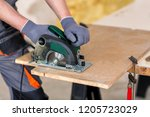 wood cutting with circular saw... | Shutterstock . vector #1205723029