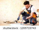 young worker removing old... | Shutterstock . vector #1205723743