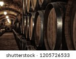 wooden barrels with whiskey in... | Shutterstock . vector #1205726533