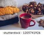 variety of sweaters piled up on ... | Shutterstock . vector #1205741926
