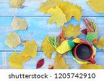 red cup with black coffee in... | Shutterstock . vector #1205742910