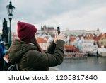 young beautiful girl tourist... | Shutterstock . vector #1205817640