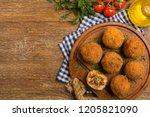 classic  italian arancini. rice ...   Shutterstock . vector #1205821090
