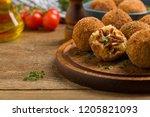 classic  italian arancini. rice ...   Shutterstock . vector #1205821093