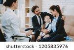 smiling family on sofa.... | Shutterstock . vector #1205835976