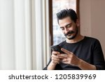 Young Mustached  Man Using...