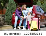 young family with suitcases... | Shutterstock . vector #1205853166