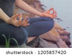 woman sitting on the rock and... | Shutterstock . vector #1205857420