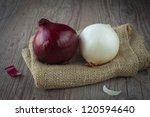 Fresh Raw Onions On A Wooden...