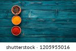 spices and herbs on a blue...   Shutterstock . vector #1205955016