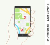 hand holding phone with map and ... | Shutterstock . vector #1205989846
