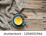 rough woolen sweater  cup of...   Shutterstock . vector #1206031966