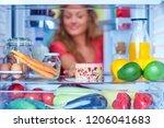 woman taking gateau form fridge ...   Shutterstock . vector #1206041683
