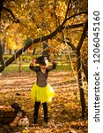 girl in halloween holiday is... | Shutterstock . vector #1206045160