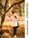 girl in halloween holiday is... | Shutterstock . vector #1206045166