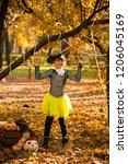 girl in halloween holiday is... | Shutterstock . vector #1206045169