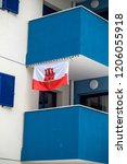 Gibraltar, United Kingdom, 30th September 2018:- Modern apartment buildings along North Mole Road in Gibraltar flying the Gibraltar flag. Gibraltar is a British Overseas Territory. - stock photo