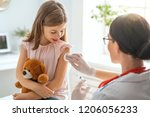a doctor making a vaccination... | Shutterstock . vector #1206056233