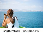 young woman on ferry looking... | Shutterstock . vector #1206064549