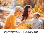 grandmother and mother smiling... | Shutterstock . vector #1206071053