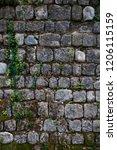 ancient wall of gray stones... | Shutterstock . vector #1206115159