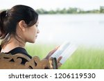 woman praying and reading on...   Shutterstock . vector #1206119530