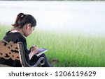 woman praying  on holy bible in ...   Shutterstock . vector #1206119629
