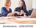 businesswomen with tablet... | Shutterstock . vector #1206139330