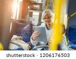 senior passenger using digital... | Shutterstock . vector #1206176503