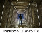 a man stands in the industrial... | Shutterstock . vector #1206192310