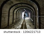 a man stands in the industrial... | Shutterstock . vector #1206221713
