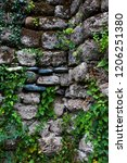 ancient wall of gray stones... | Shutterstock . vector #1206251380