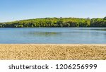 green coast line of the lake.... | Shutterstock . vector #1206256999