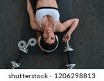 girl stretches on mat with...   Shutterstock . vector #1206298813