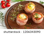 tasty egg muffins wrapped in... | Shutterstock . vector #1206343090