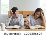 stressed male and female... | Shutterstock . vector #1206356629