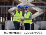 twp satisfied engineers talking ...   Shutterstock . vector #1206379033
