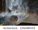 Rainbow Above The Wet Rocks At...