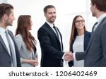 handshake to make a deal with... | Shutterstock . vector #1206402469