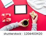 female hands  woman holding a...   Shutterstock . vector #1206403420