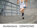 young woman runner sportswoman... | Shutterstock . vector #1206452560