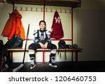 boy preparing for ice hockey... | Shutterstock . vector #1206460753
