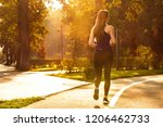 girl run in the autumn park.... | Shutterstock . vector #1206462733