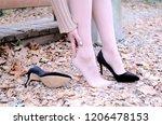 tired woman feet in high heels...   Shutterstock . vector #1206478153